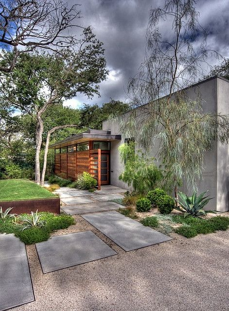 A modern mixer of gravel and pavers with a twist of plants...love!