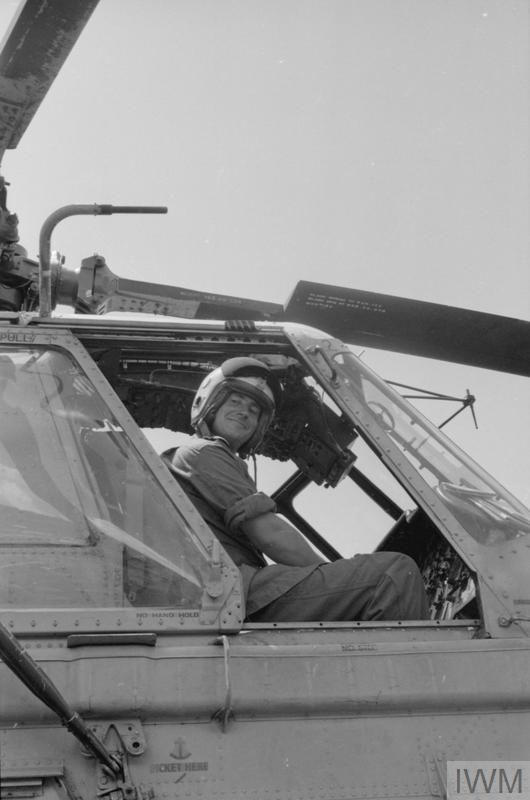 Lieut MacPherson in his Wessex helicopter in Sarawak.