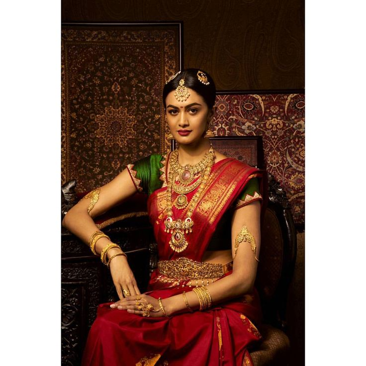 South Indian bride. Gold Indian bridal jewelry.Temple jewelry. Jhumkis. Red silk kanchipuram sari. Braid with fresh jasmine flowers. Tamil bride. Telugu bride. Kannada bride. Hindu bride. Malayalee bride.Kerala bride.South Indian wedding. Pinterest: @deepa8