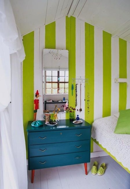 Repaint a vintage dresser with a contemporary color, add a few bold stripes on the wall for a vintage feel in this teen bedroom...