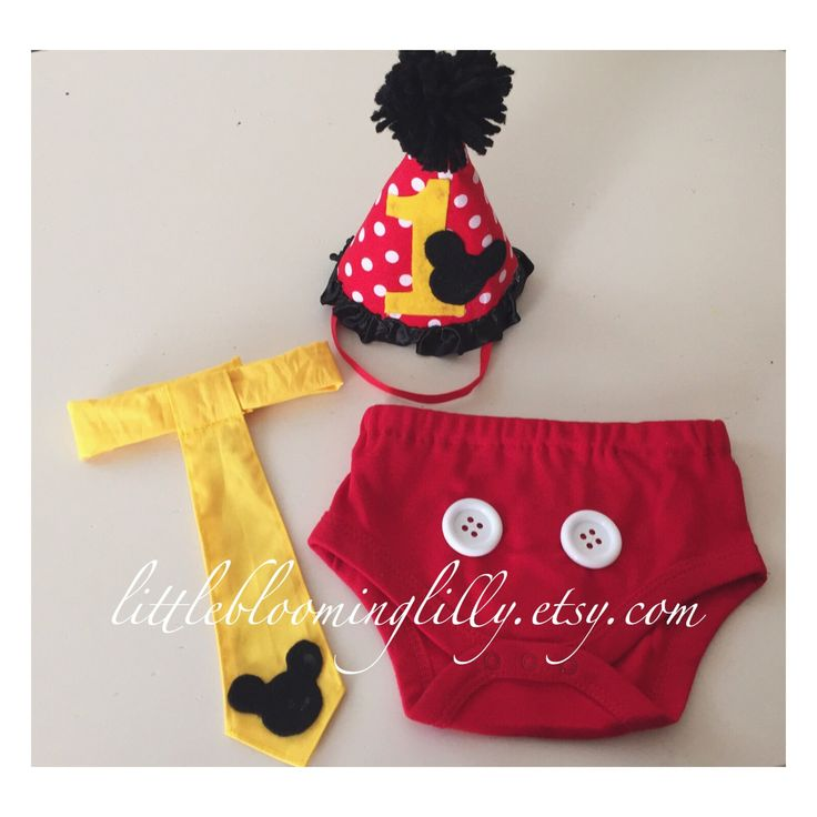 This set is perfect for a first birthday outfit! Set includes with hat, bloomers & velcro tie. *materials may be slightly different from picture above--(such as size of buttons or hat elastic)*
