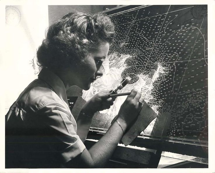 1944- U.S. Navy WAVE Mary Eleanor Palmquist engraves a negative of ocean depths at the Navy Photographic Office in Suitland, Maryland.