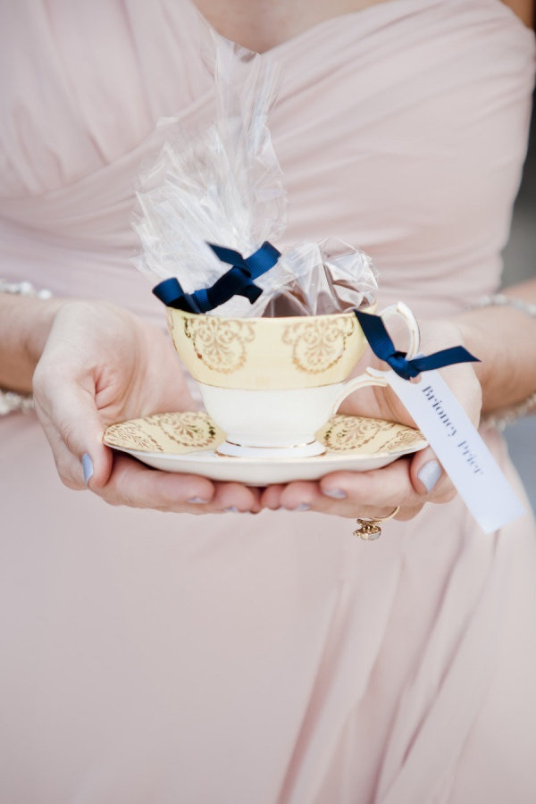 A pretty teacup does double duty as a place card and favor Photography by lavara.co.nz, Floral Design by rosesflorist.co.nz