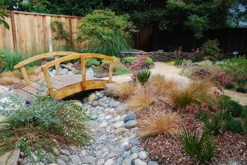 Asian inspired. Dry riverbed and bridge, paths and perennials