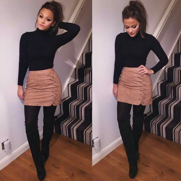 Black turtleneck, skirt, black tights, black boots, pony tail