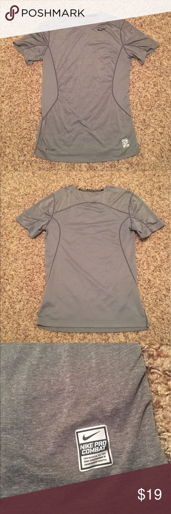 Gray NIKE PRO COMBAT FITTED shirt Gray Nike dri- fit shirt! In EXCELLENT USED CONDITION. pro combat & fitted. The back is mesh material as shown in a close up picture. Nike Shirts Tees - Short Sleeve