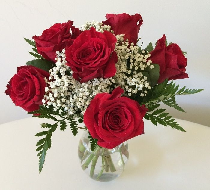 Half a dozen of romantic red roses in a vase, $49.95 (http://www.myriadblossoms.com/im-devoted-to-you/)