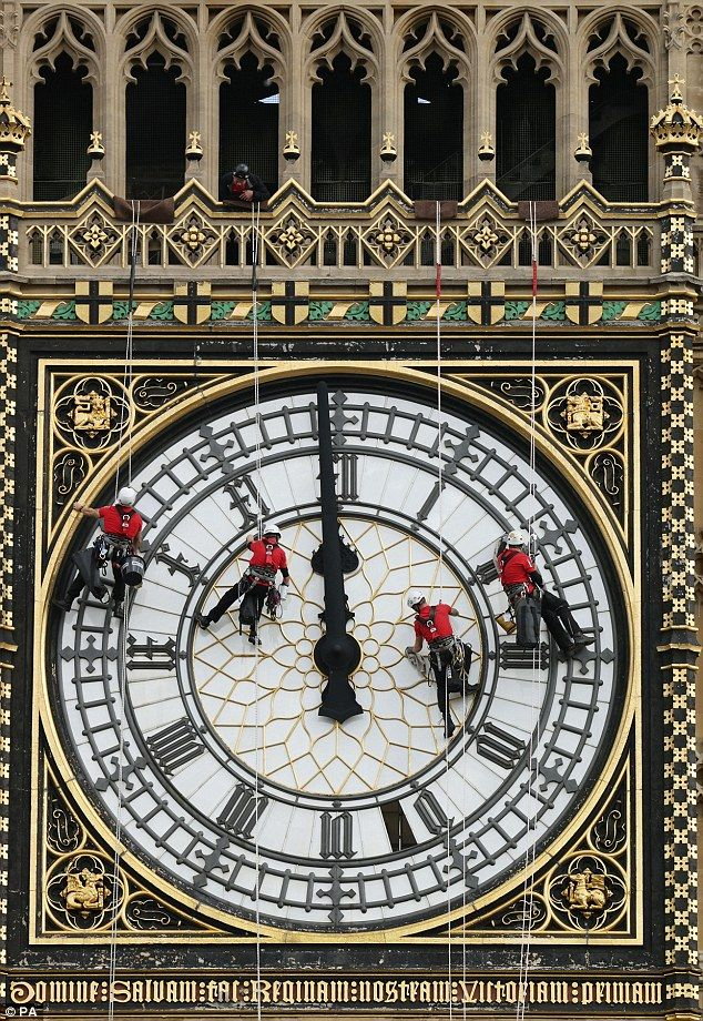 The team of cleaners abseiled down from the top of the tower to clean the face of the famous clock, Big Ben, London
