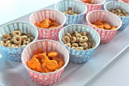 Cheerios and goldfish snacks for first birthday.  See more 1st boy birthday snacks and party ideas at one-stop-party-ideas.com