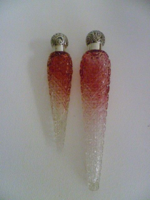 A Victorian-era lachrymosa, also called lachrymatory, tear catchers, or tear vials. Sometimes worn on a necklace, sometimes merely held, they were used the gather the tears wept by mourners at funerals. One type of lachrymosa had a special top which allowed the tears to evaporate (signifying the time to stop mourning), others had a sealed top to allow the tears to last for a year, at which point they would be poured on the grave of the person whom the tears were wept for.