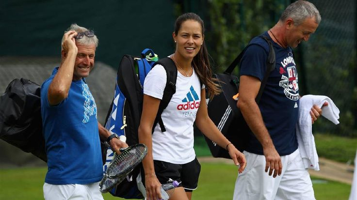 Ana Ivanovic of Serbia in good spirits with her coach Nigel Sears after a practice session