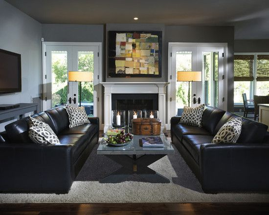 How to decorate around the black leather couch living for Small family living room ideas