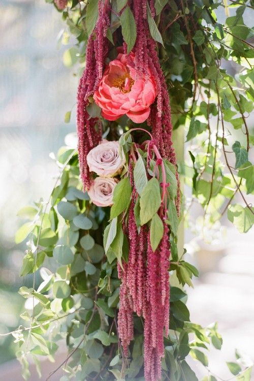 Hanging amarathus (green also) is perfect for decorating an arch or any kind of column at your ceremony or reception space. Just work in other flowers in the color scheme along the way.