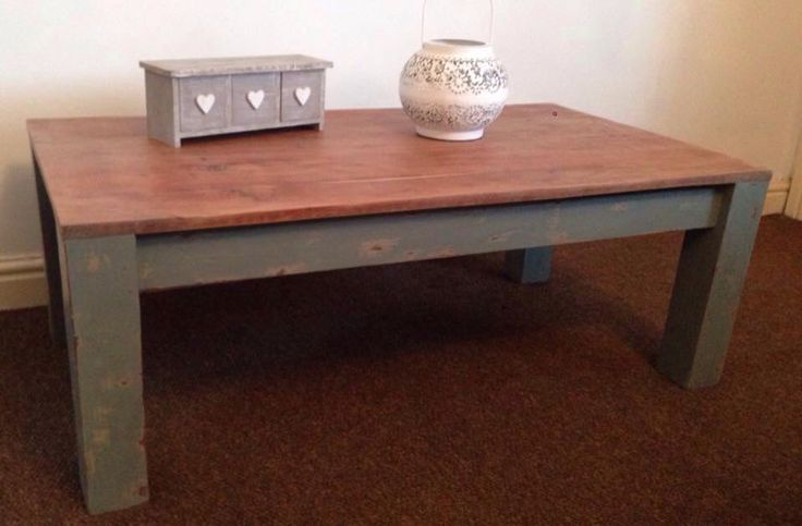 Solid wood coffee table. Painted in Country Grey with an overlay of Duck Egg. The Duck egg was sanded down to reveal hints of the Country Grey underneath. The top of the table sanded down to its original wood and waxed for protection. Now for sale £100.