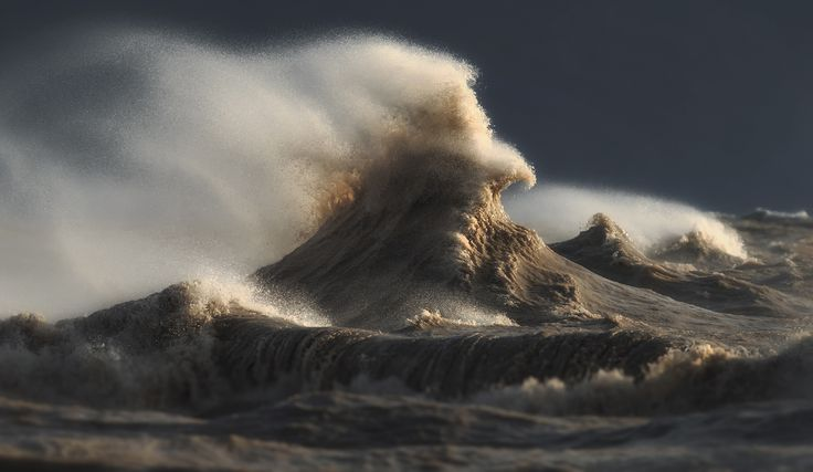 Surreal photos of crashing waves caught in motion on Lake Erie
