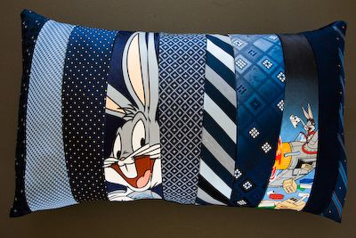Pillow from old neckties...OK I really like this tie project. Select ties of similar colors and go to town. I love how this example uses Looney Toon ties to lighten things up.