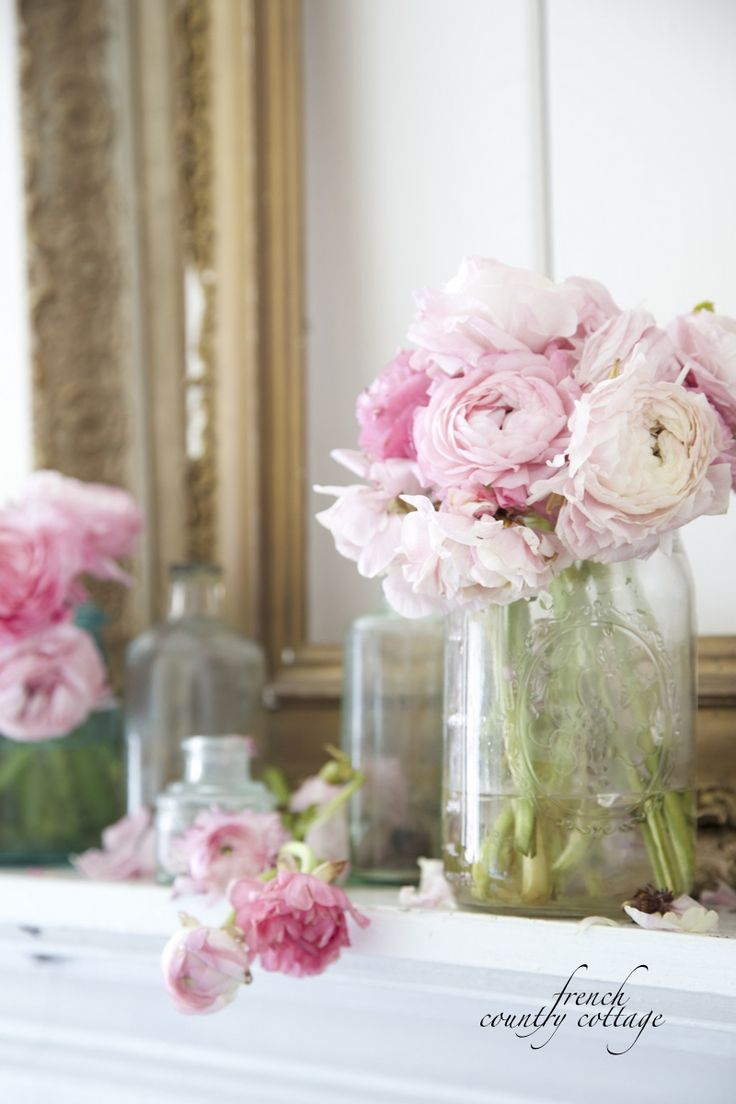 Romantic, elegant, and understated Spring mantel with flowers, vintage bottles, and gilded frames. Perfection!