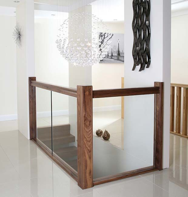 Glass balustrade with black walnut hand and base rail
