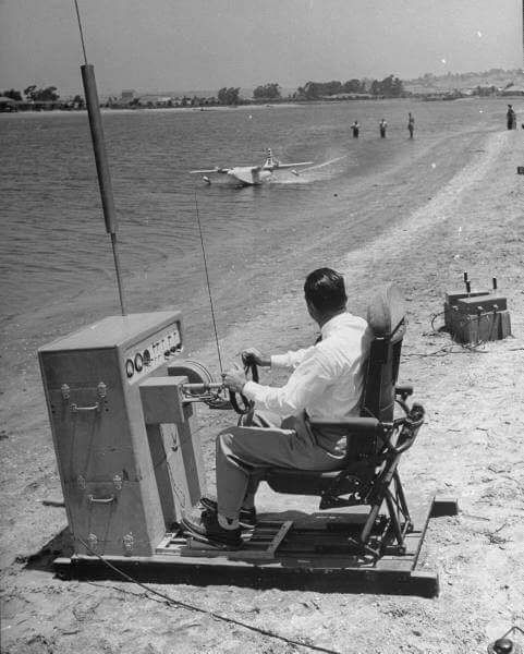 Howard Hughes test flying a scale test model of the Hughes H-4 Hercules (better known as the Spruce Goose, a name that Hughes hated).