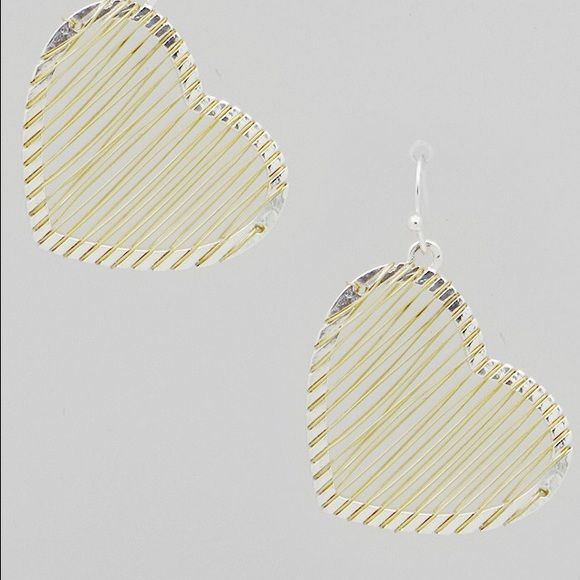 Silver Tone Heart Earrings with Gold Silver Tone Heart Earrings with Gold.  The heart is silver and the wrap around wire is gold.    Item tag states: Not intended for children under 14 years of age. Earrings ornament hangs approx. 1 inch. Jewelry Earrings