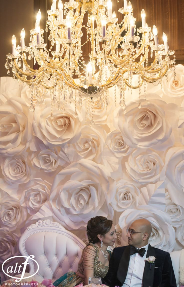 Bridal portraits in front of their paper flower wall at the Mandarin Oriental. Luxury IndianLas Vegas Wedding Planner Andrea Eppolito. Photo by Altf. Florals, Decor, and Entertainment by DBD Vegas.