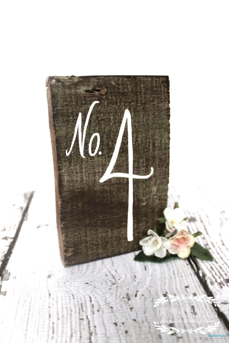 TABLE NUMBERS: This would be nice if they can be ordered with whitewashed wood to match the fish and lettering/numbers in color. Can be simply leaned against centerpieces. Rustic Wooden Table Numbers. $4.00, via Etsy.