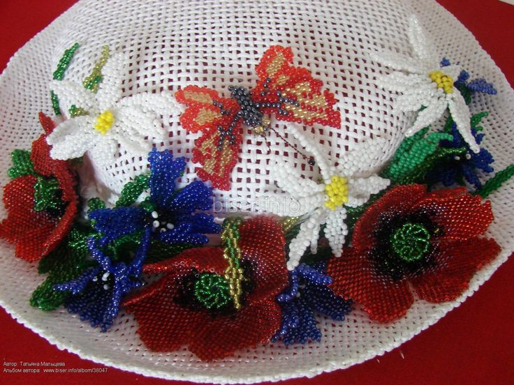 White summer hat with red poppies
