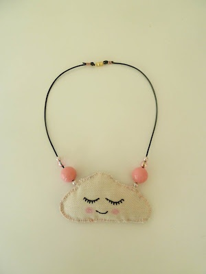 Necklace - Sleepy Cloud.  This would be adorable with rainbow colored ribbons hanging from the bottom.  ;)