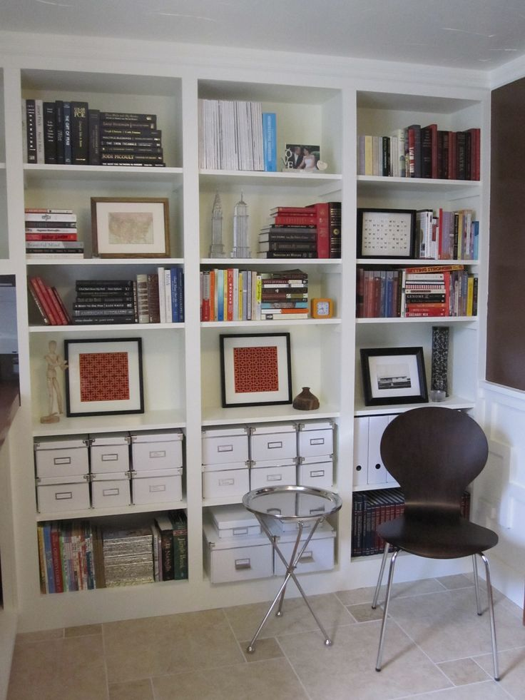 Bookshelves on either side of the desk with doors that cover either the bottom or the whole thing