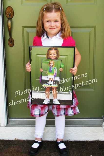 So cute. Picture within a picture of previous first days of school.