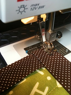 not that i need another, but this is a good machine quilt binding tutorial which also links up to other machine binding tutorials.
