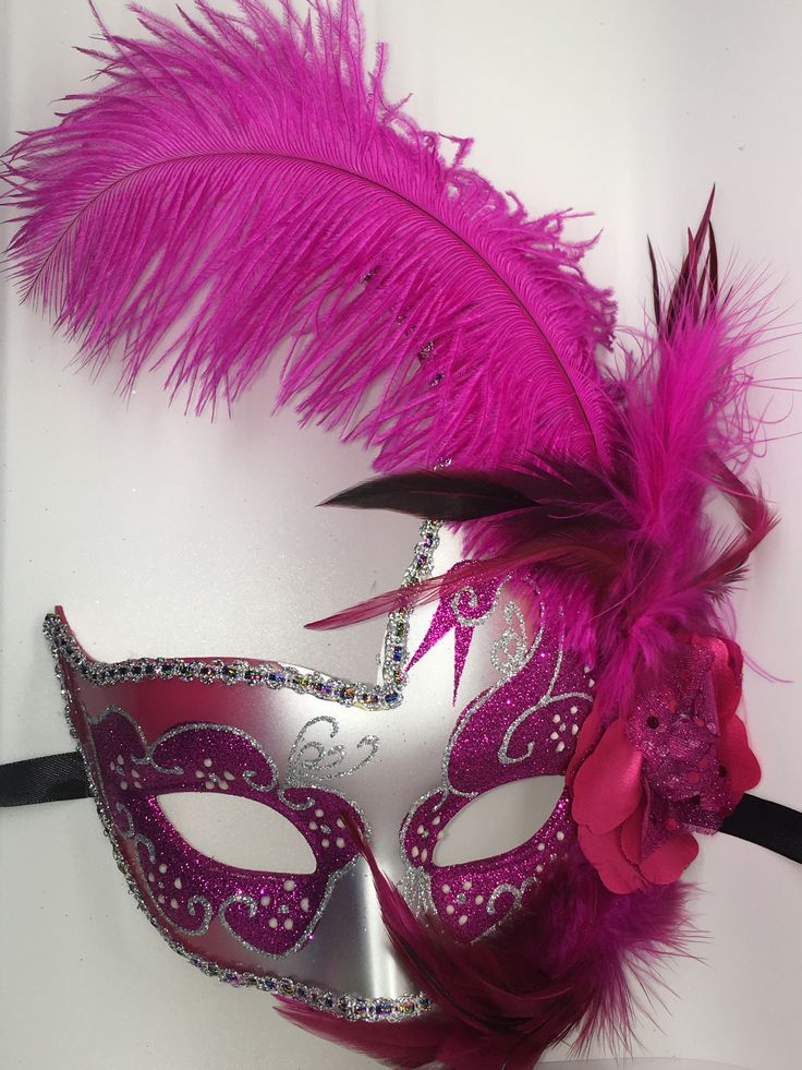 Pink and silver Mardi Gras Masquarade mask with ribbon ties.