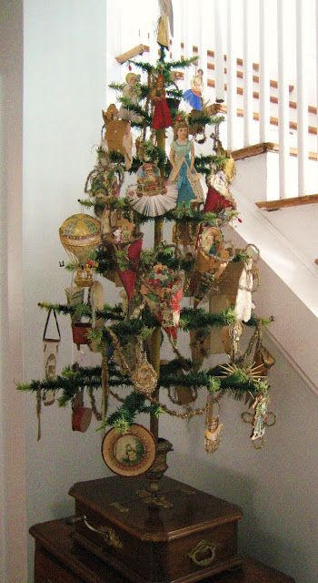 Victorian style green goose feather tree with Dresden, scrap ornaments, and embellished cones.