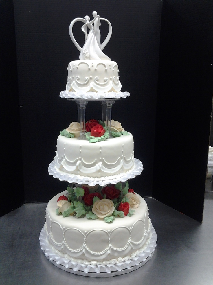 3 tier wedding cake by Roly's Bakery. Buttercream