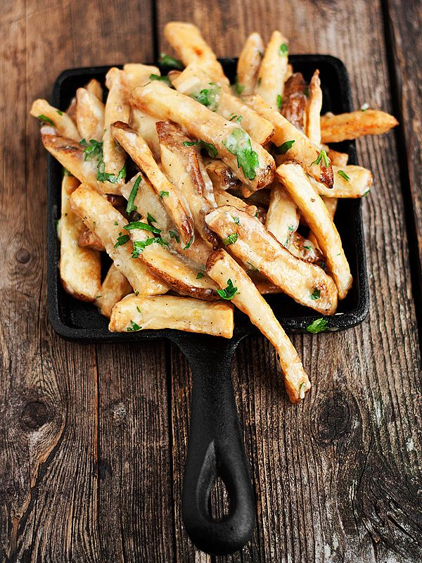 Oven-baked Fries All Dressed! Fries, homemade gravy, aged cheddar, Parmesan and fresh herbs.
