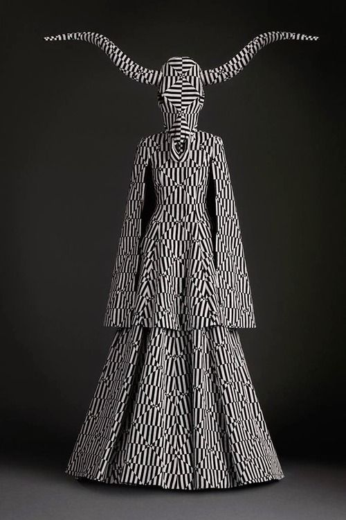 Gareth Pugh has concentrated on pattern by really spreading a repetitive print all over the garment including the head dress.