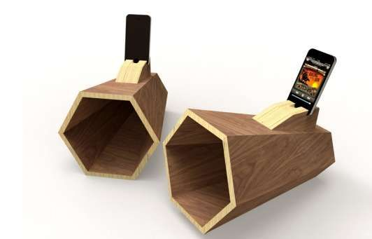 It's assembled from about seven pieces of rich dark lumber into an open and broadening six-sided prism. Your mp3 player needs simply be slipped into it and the well-crafted chamber will accentuate the sound from the tiny handset speaker.