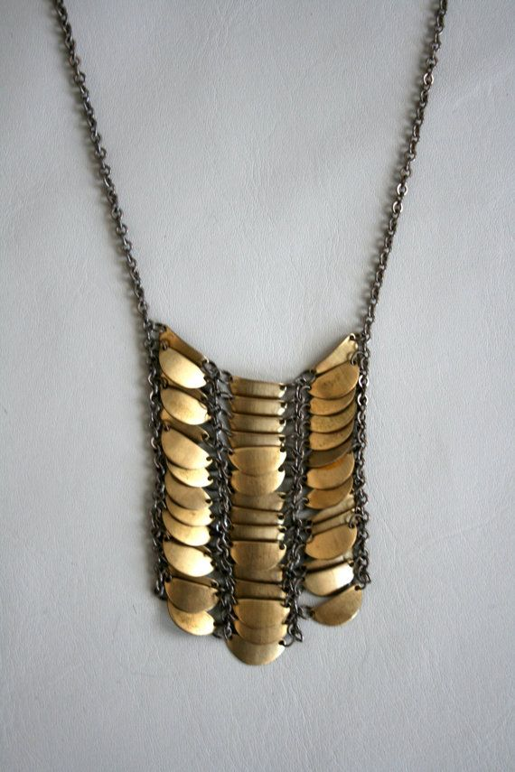 Long brass necklace can be worn with a casual outfit or give a formal look more edge.
