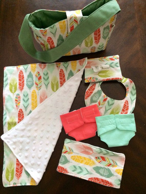 Perfect way to be just like mommy or daddy. This diaper bag comes with two cloth diapers, wipe case with wipes inside, burp cloth, bib, and a blanket. This item makes the perfect gift for a special holiday, for a new baby in the family, or a just because gift! -with this diaper bag, the burp cloth and blanket have a soft minky on the back.  *custom orders are available with this item. If you wanted a different fabric pattern! Message me with any questions! * for custom orders, turn around…