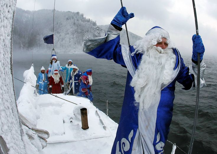 "Members of the ""Skipper"" yacht club dressed as Ded Moroz, the Russian equivalent of Santa Claus, and his granddaughter Snegurochka (Snow Maiden) sail a yacht along the Yenisei River while marking the end of the sailboat season, with the air temperature at about minus 21 degrees Celsius (minus 5.8 degrees Fahrenheit), outside the Siberian city of Krasnoyarsk, Russia."