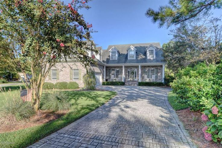 Wilmington, NC | Meticulously maintained home on a high lot overlooking the 15th fairway of the golf course at Porters Neck Plantation! Open concept floor plan is ideal for entertaining. Features a 2-story great room, a gas log fireplace, built-in shelving, access to an all-seasons porch overlooking the beautifully landscaped yard. Gourmet kitchen has a 5-burner gas cooktop, double oven, huge island. Dine in the formal dining room or breakfast nook. 1st-floor master suite has a larg...