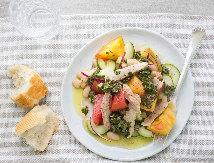 We could eat salsa verde on pretty much anything, and its particularly good on this tomato and white bean salad. Serve with crusty bread to sop up all of the lovely juices.
