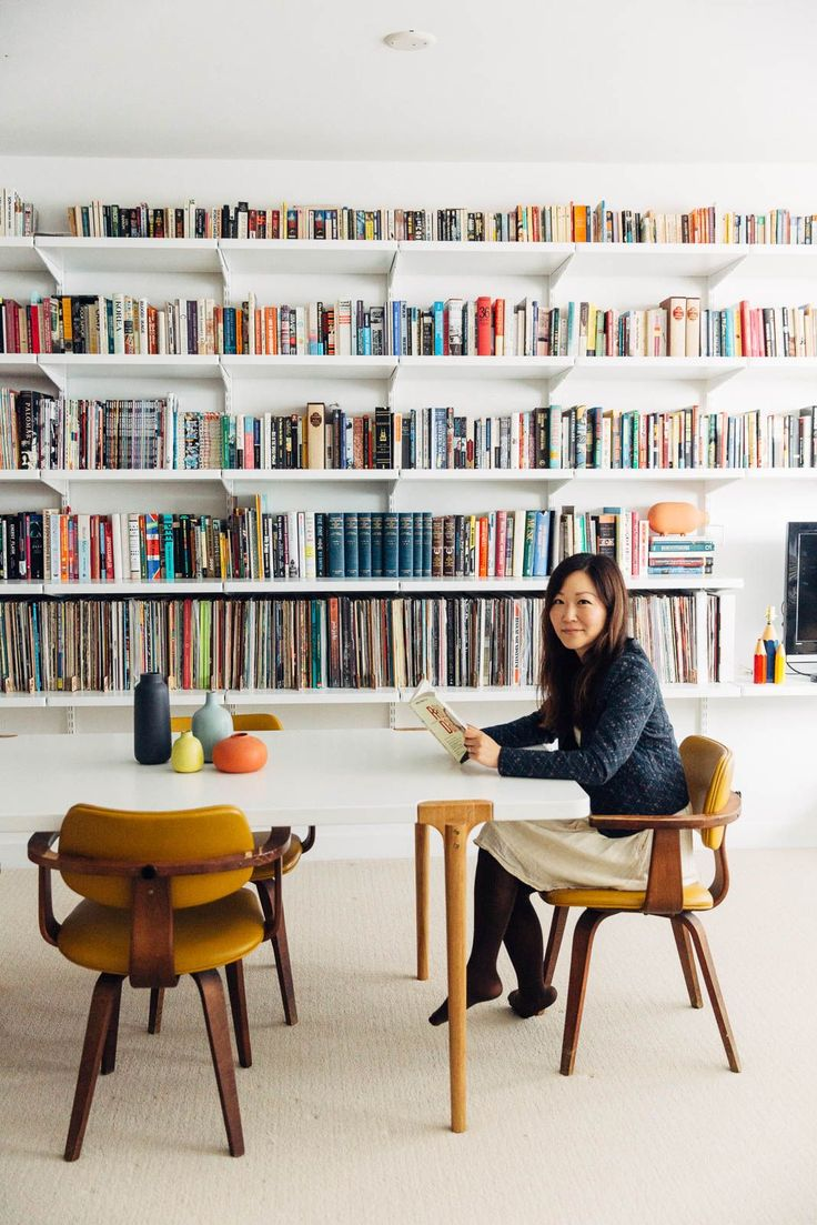 """These Bookshelves Take #Shelfies To The Next Level #refinery29  http://www.refinery29.com/bookcase-shelfie-organization-pictures#slide-9   Donna Suh, Social Media Manager & Product Scout At Heath Ceramics""""We tinkered with how to categorize and arrange books and records both functionally and aesthetically,"""" she says. """"But honestly, this whole thing took way less time than we thought it might, and it's had a transformative effect on our previously cluttered living room. Turns out books don't…"""