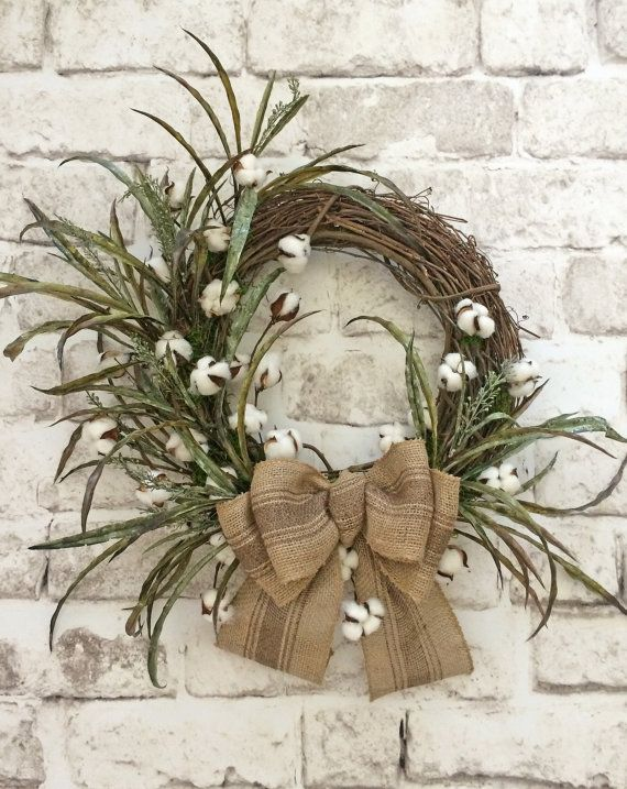 Cotton Boll Wreath, Cotton Wreath, Summer Wreath, Front Door Wreath, Etsy - This charming cotton wreath was handmade using a natural grapevine wreath base adorned with branches of cotton bolls, greenery, and a large burlap bow. This wreath would look wonderful on your front door, above your mantel, or on an interior wall. What a wonderful way to bring the outdoors in. This is the perfect wreath to display anytime of year! • Already made and ready to ship! • Measures approximately (tip to…