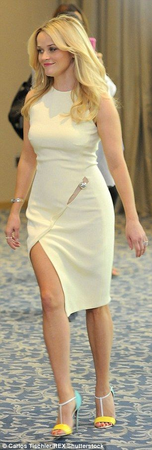 White hot:For their photo call, Reese stepped out in a high necked white dress with an as...