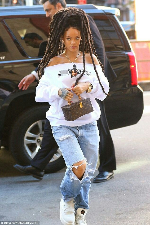 Rihanna rocks new dreadlocks as she goes casual cool in off-the-shoulder sweater and ripped jeans in New York