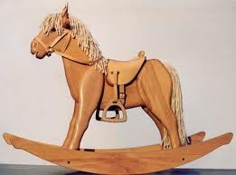 Giddy-up Horsey ....go to town...to get Debbie some candy....giddy-up Horsey, don't fall down...or you'll spill Debbie's candy!   This was from my childhood!!  Now this would be an awesome wooden rocking horse to make.