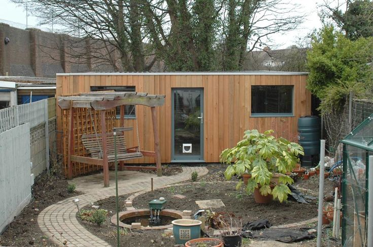 Cedar clad concrete garage - interesting path, planting ideas - plus cedar cladding
