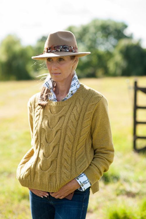 womens country trilby with feather trim by Holly Young Millinery. Chunky cable knit cashmere sweater by Cashmere and Cotton #country #cashmere #hats #luxuary #2016 #2017 #womens #fashion #knitwear #trilby #hats #mustard #yellow #brown #uk #british #england