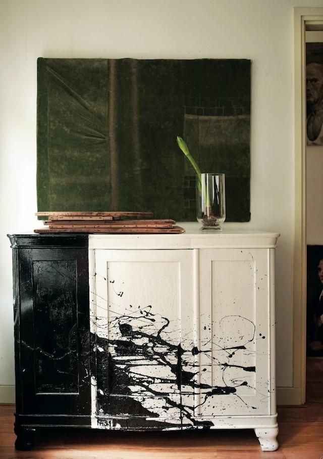 Paint Spattered Cabinet by Leslie Oschmann of Swarm. Easy DIY: lay cabinet on its back, open black paint, pretend you're Jackson Pollock.